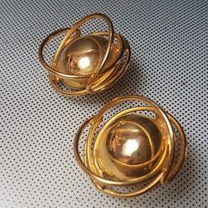 orbit atomic clip earrings goldtone